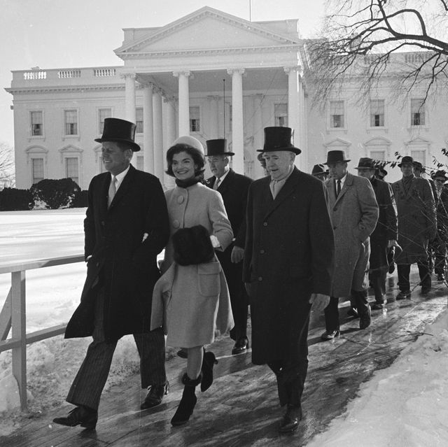married couple, us president elect john f kennedy 1917   1963 and jacqueline kennedy nee bouvier, later onassis, 1929 – 1994, along with others, walk to the formers inauguration day ceremony, washington dc, january 20, 1961 photo by paul schutzerthe life picture collection via getty images