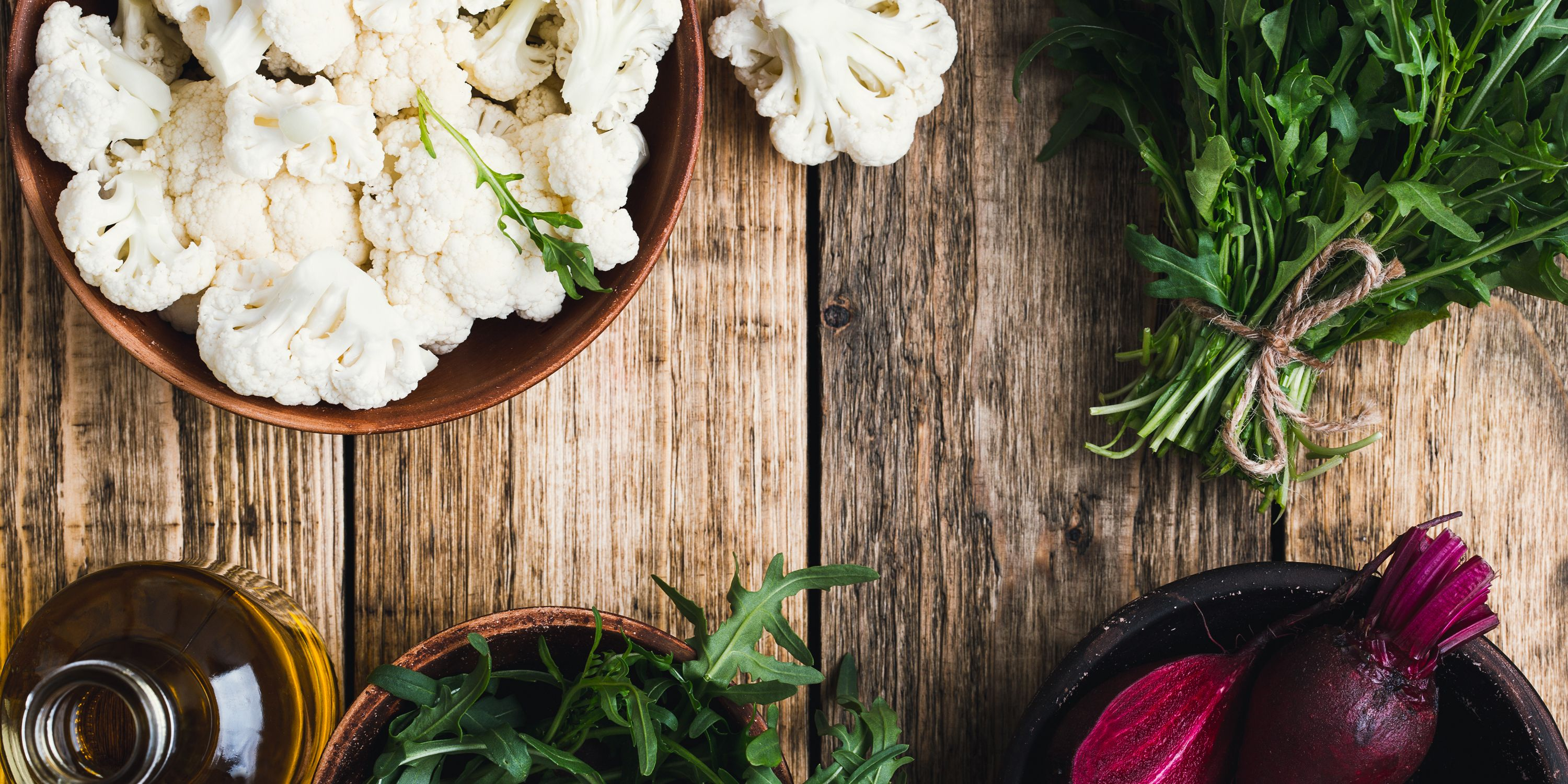 High angle view composition of fresh raw organic vegetables on rustic wooden table