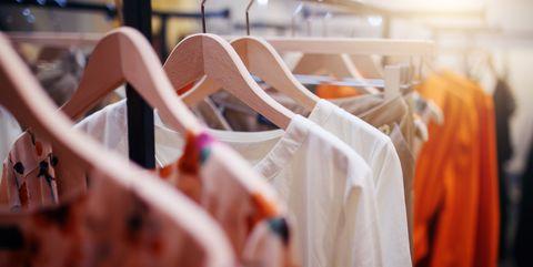 Clothes hanger, Orange, Pink, Fashion, Dress, Room, Boutique, Textile, Fashion design, Peach,