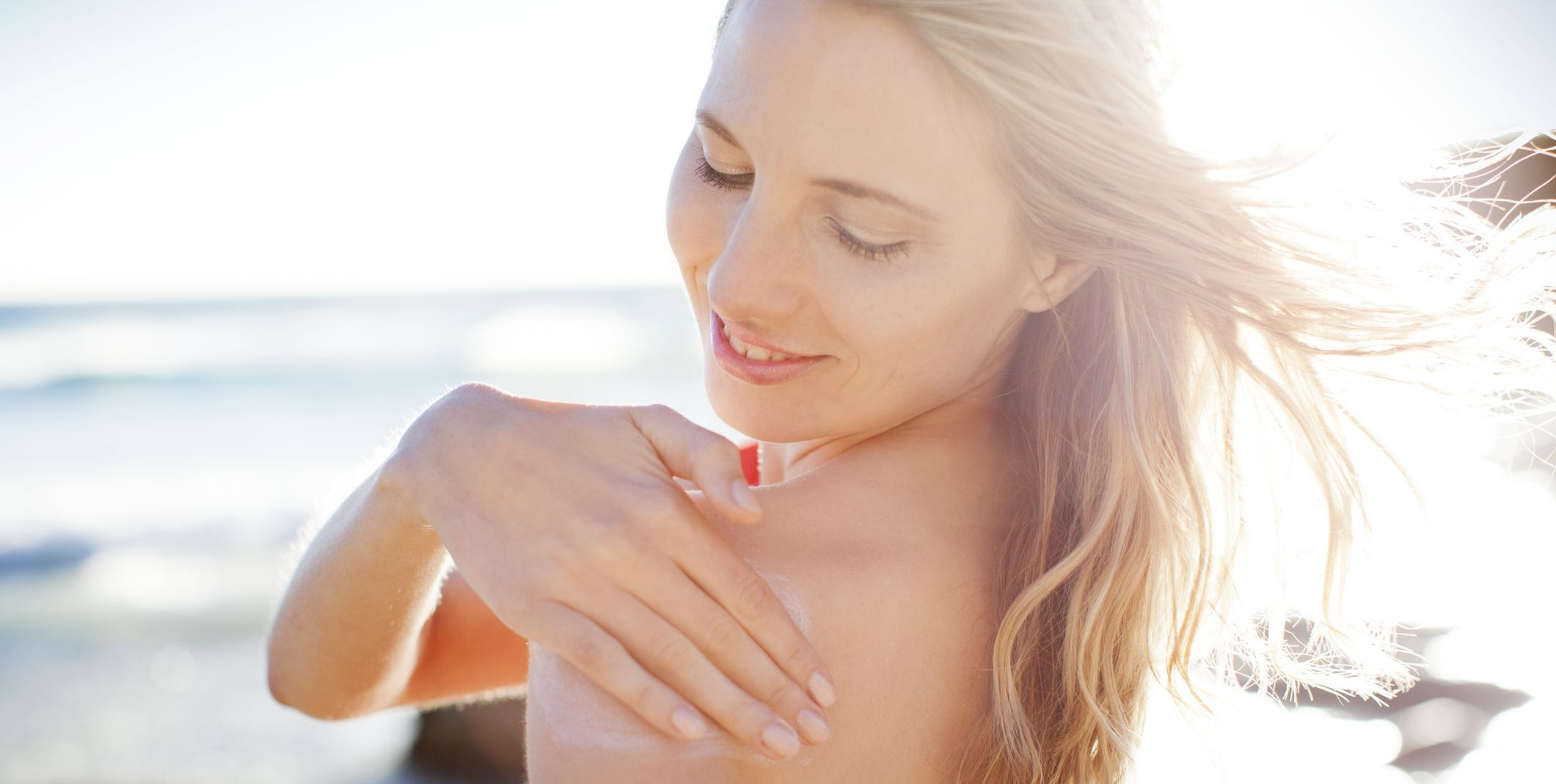 Applying Sunscreen to Shoulder
