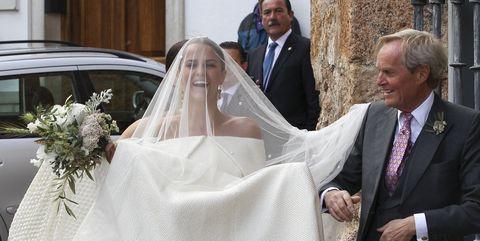Bride, Veil, Wedding dress, White, Photograph, Bridal veil, Gown, Ceremony, Bridal clothing, Bridal accessory,