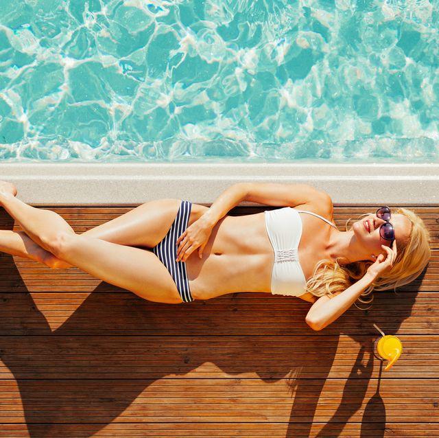 Leg, Blue, Sun tanning, Beauty, Turquoise, Fun, Summer, Happy, Arm, Human leg,