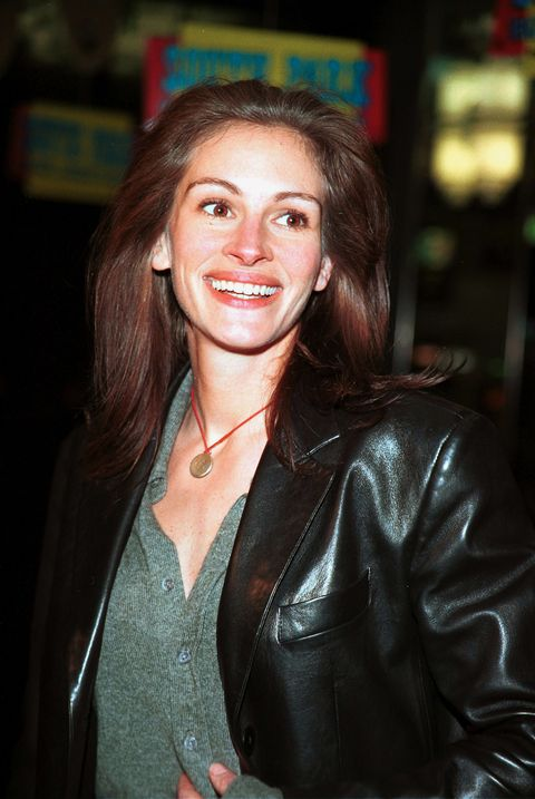 Hair, Beauty, Leather, Smile, Leather jacket, Lip, Textile, Jacket, Brown hair, Long hair,
