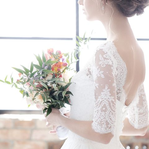 bride holds flowers