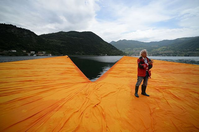 artist christo vladimirov javacheff walks on his monumental installation the floating piers he created with late jeanne claude, on june 16, 2016 during a press preview at the lake iseo, northern italy some 200,000 floating cubes create a 3 kilometers runway connecting the village of sulzano to the small island of monte isola on the iseo lake for a 16 day outdoor installation opening on june 18  afp  filippo monteforte  restricted to editorial use   mandatory mention of the artist upon publication   to illustrate the event as specified in the caption        photo credit should read filippo monteforteafp via getty images