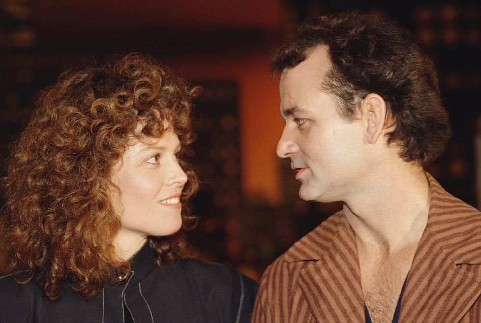 Sigourney Weaver and Bill Murray attend the premiere of the movie Ghostbusters , directed and produced by Ivan Reitman in 1974.