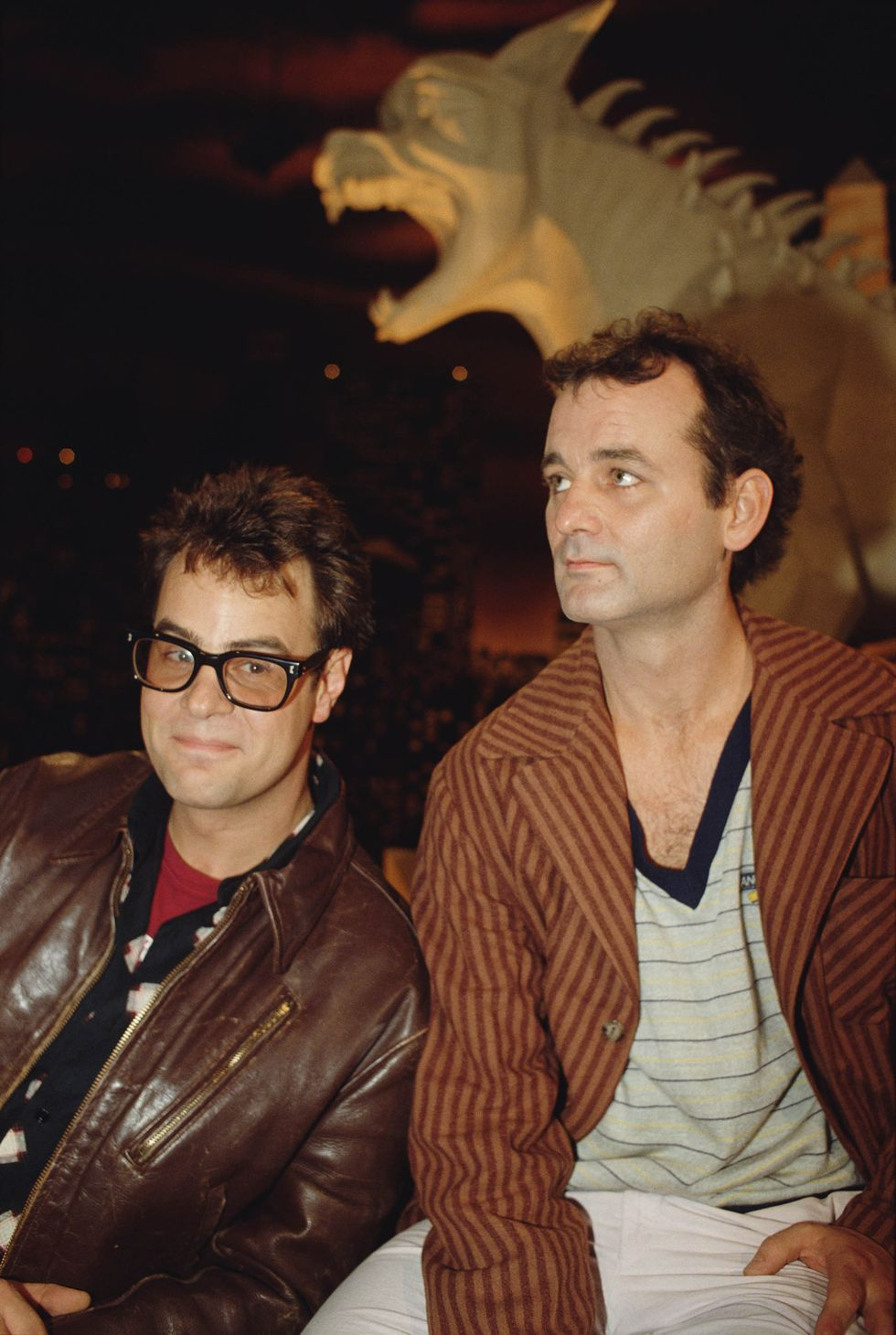 Dan Aykroyd and Bill Murray attend the premiere of the movie Ghostbusters , directed and produced by Ivan Reitman in 1974.