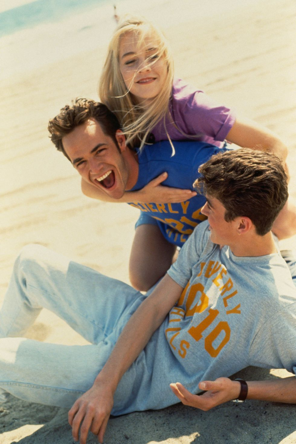 Perry, Jennie Garth, and Brian Austin Green from the television series Beverly Hills, 90210 in 1991.