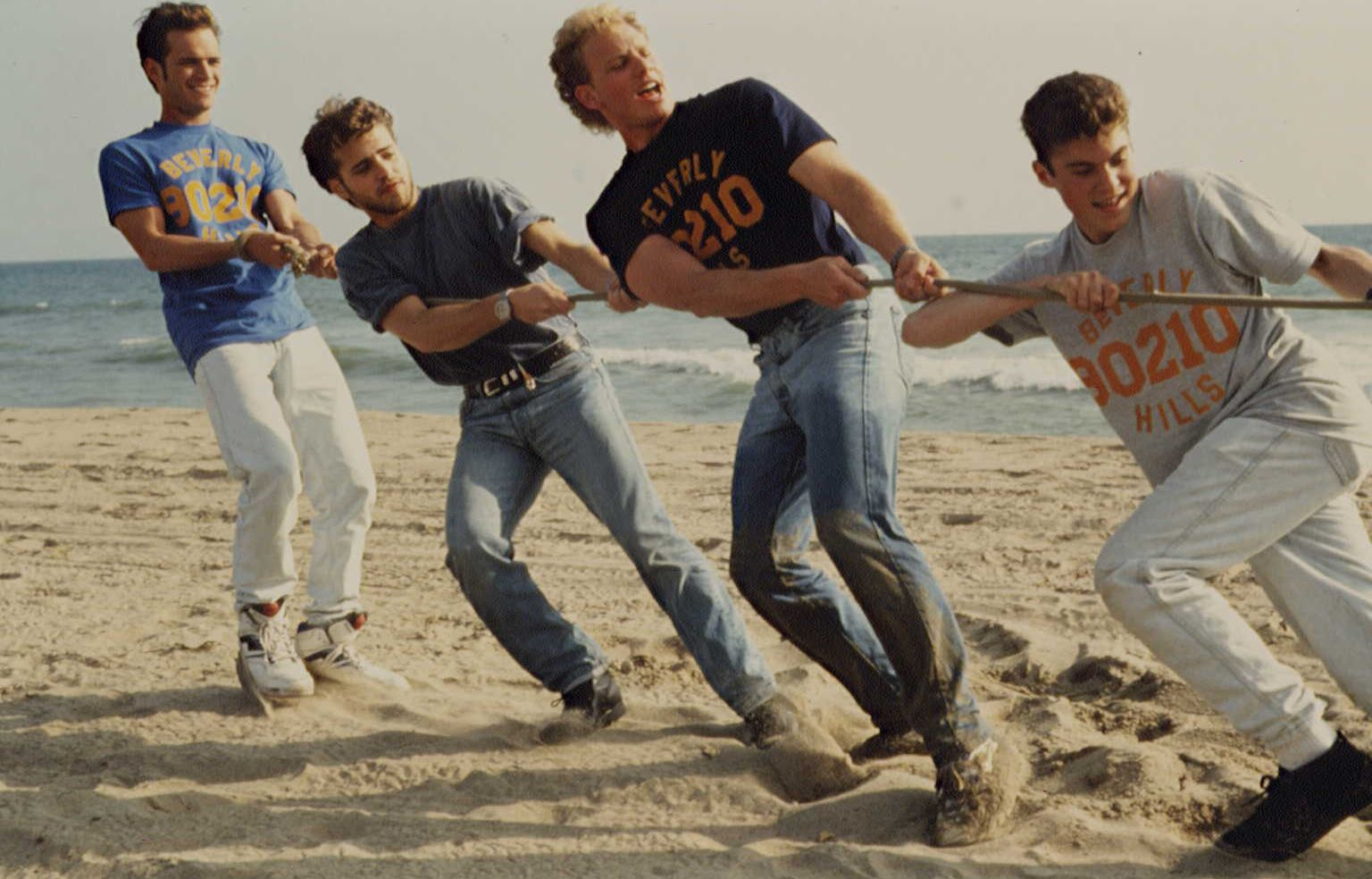 Luke Perry, far left, in a promotional photo from 1991 with his co-stars on Beverly Hills, 90210: Jason Priestley, Ian Ziering, and Brian Austin Green.