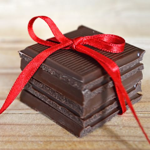 Pile of chocolate with red ribbon