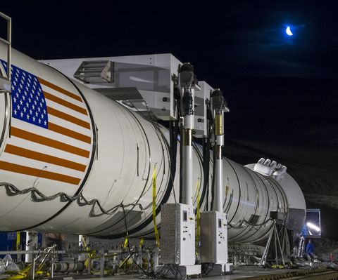 In this handout provided by NASA, the moon rises ahead of the second and final qualification motor (QM-2) test for the Space Launch System's booster on Tuesday, June 28, 2016, at Orbital ATK Propulsion Systems test facilities in Promontory, Utah.
