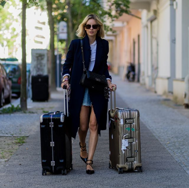 berlin, germany   june 28 lisa hahnbueck travelling with rimowa suitcase during the mercedes benz fashion week berlin springsummer 2017 on june 28, 2016 in berlin, germany photo by christian vieriggetty images