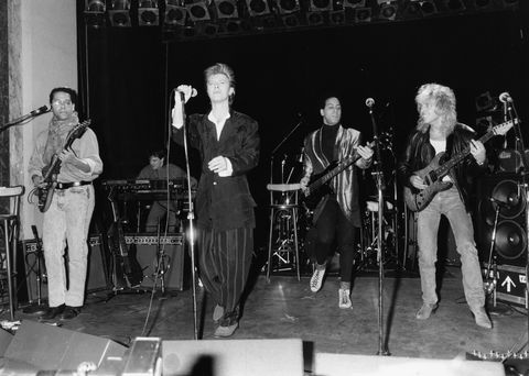 musician david bowie performing with his new band, including guitarist peter frampton far right, march 25th 1987 photo by dave hogangetty images