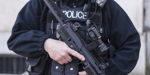 Ballistic vest, Swat, Police, Outerwear, Jacket, Personal protective equipment, Police officer, Security, Law enforcement, Official,