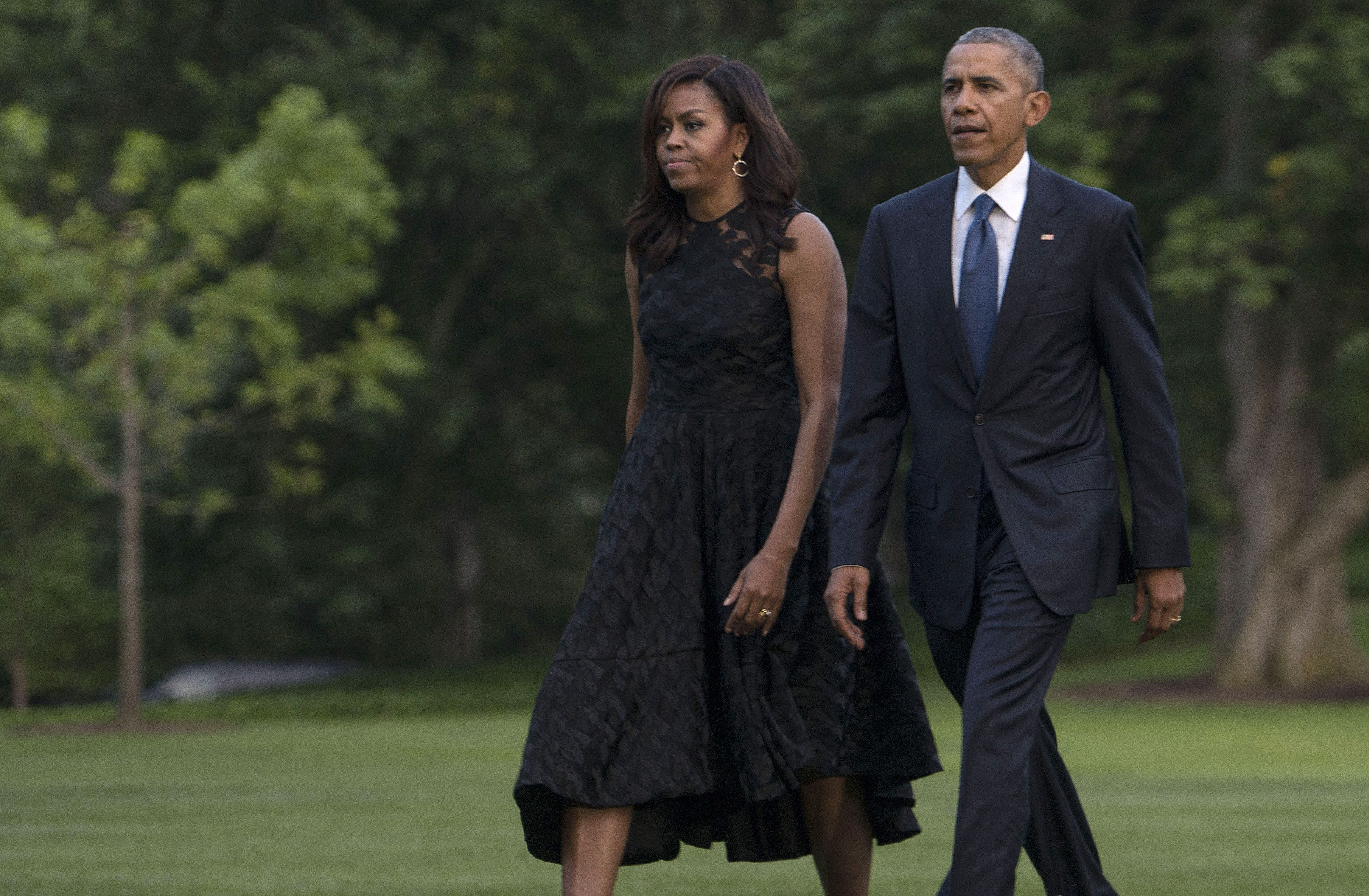 First Lady Michelle Obama and President Barack Obama exit Marine One in July, 2016.
