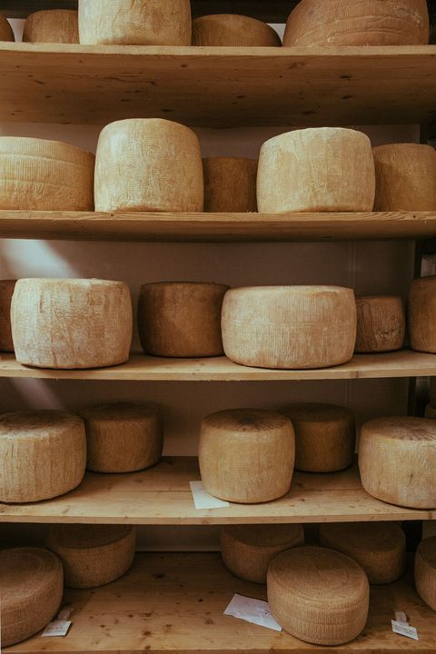earthenware, Dairy, Gruyère cheese, Pottery, Wood, Cheese, Cheesemaking, Parmigiano-reggiano, Tableware, Bowl,