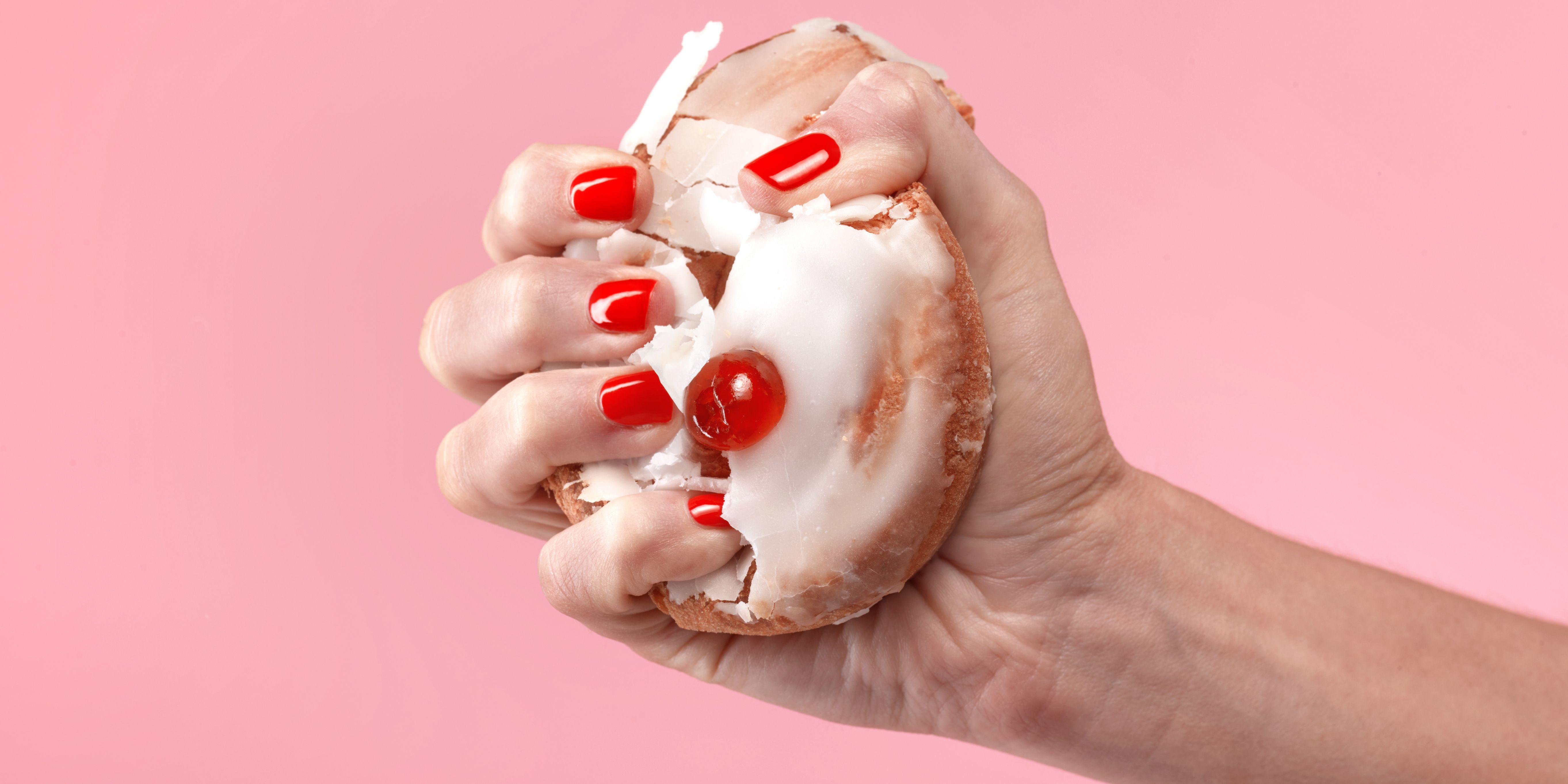 Female dieter crushing belgian bun