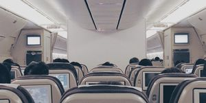 The genius way to get an entire row to yourself while flying economy