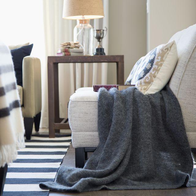 Gray blanket over chair in elegant living room
