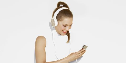 White, Skin, Arm, Leg, Hair accessory, Hairstyle, Footwear, Shoulder, Sitting, Headphones,