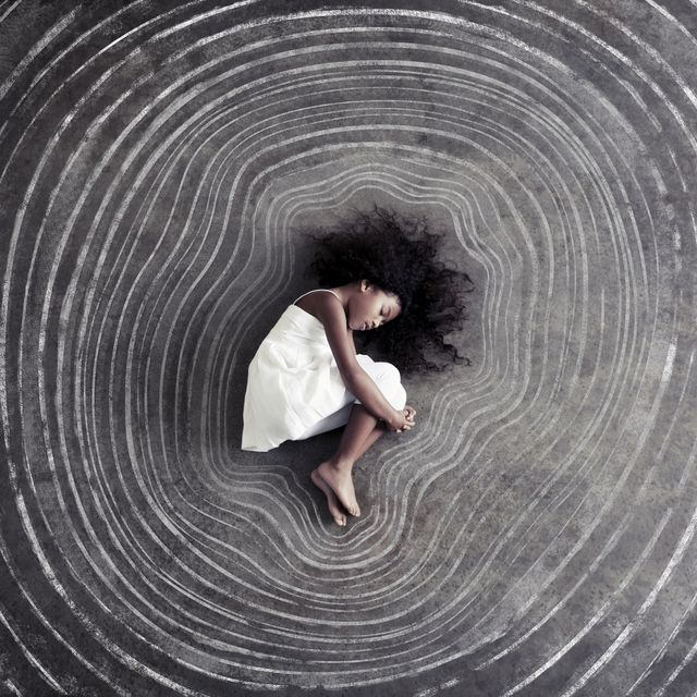 african girl curled inside pattern of growth