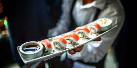 Waiter Holding Sushi