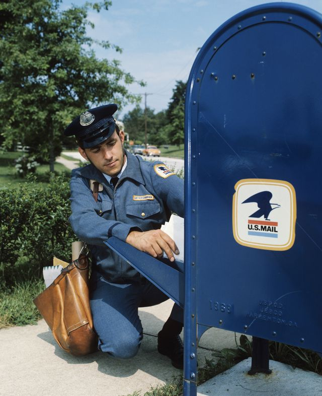 1970s mailman taking mail out of mail drop box  photo by h armstrong robertsclassicstockgetty images
