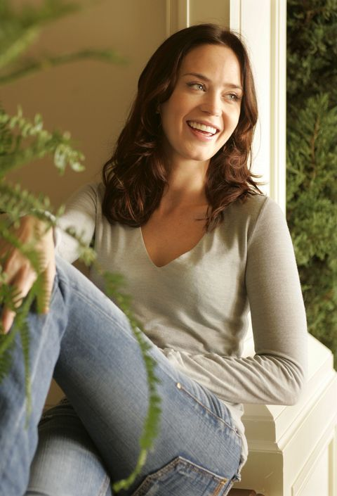 Hair, Beauty, Sitting, Smile, Photo shoot, Long hair, Sunlight, Brown hair, Jeans, Grass,