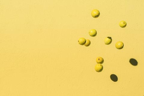 Abstract shot of lemons flying in the air