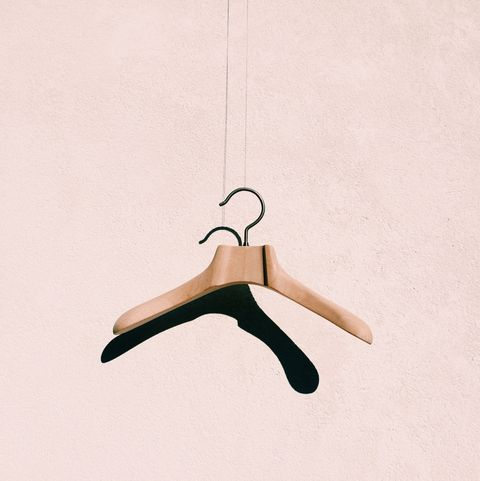Coathanger Hanging Against White Wall