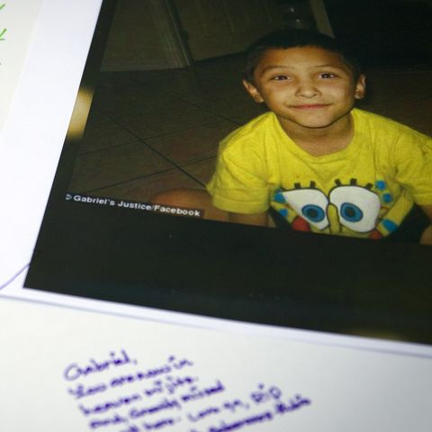 Tributes are written on a poster board during a memorial service for  Gabriel Fernandez,8, a Palmda