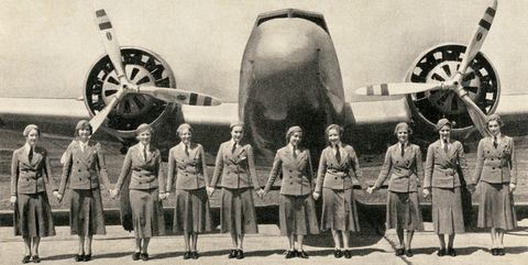 Stewardesses And Airliner
