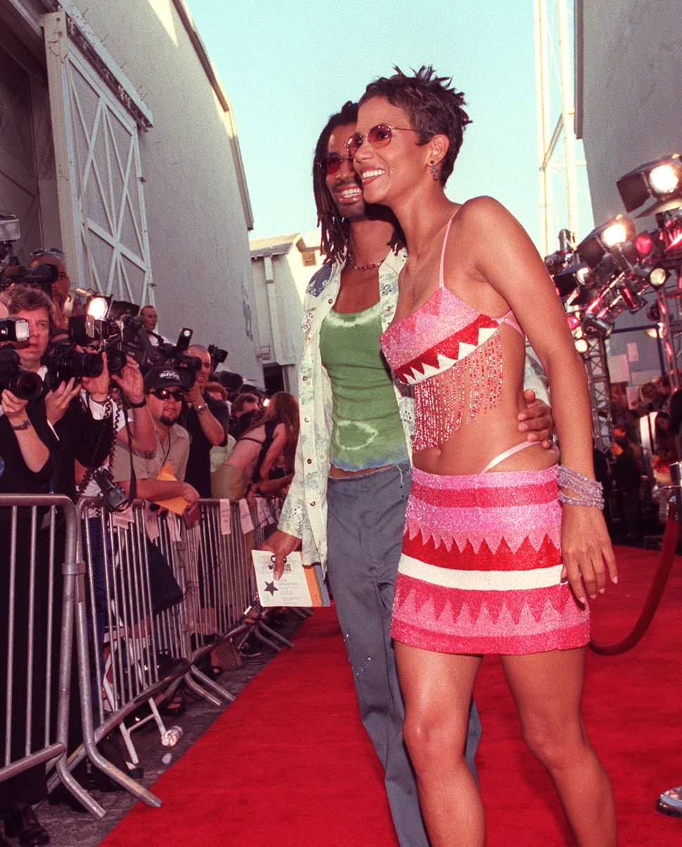 An Adventurous Look The MTV Movie Awards are a great place for celebs to try out adventurous, edgy looks. Halle followed suit in 2000 by wearing a brightly colored two-piece complete with fringe.