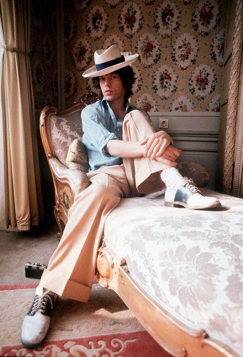Human, Hat, Human body, Textile, Shirt, Shoe, Interior design, Sitting, T-shirt, Sun hat,