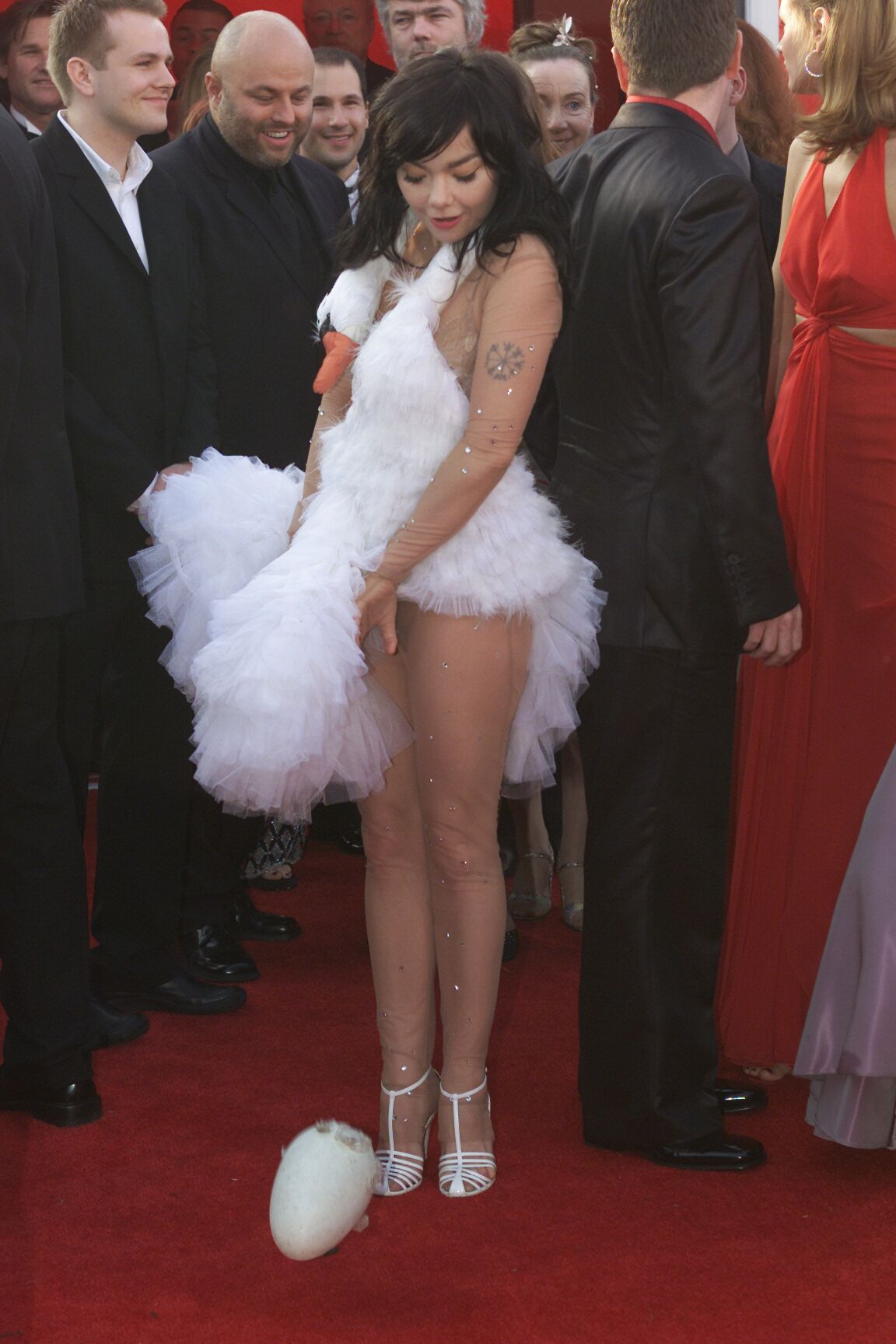 """2001: When Björk arrived in a swan dress and laid an egg on the red carpet. People were stunned when Björk walked the red carpet in a frilly swan dress—and even more so when she strategically """"laid"""" six ostrich eggs on the red carpet."""