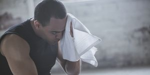 Athlete wiping sweat with towel