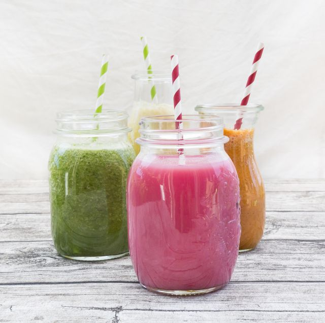 four glasses of different smoothies
