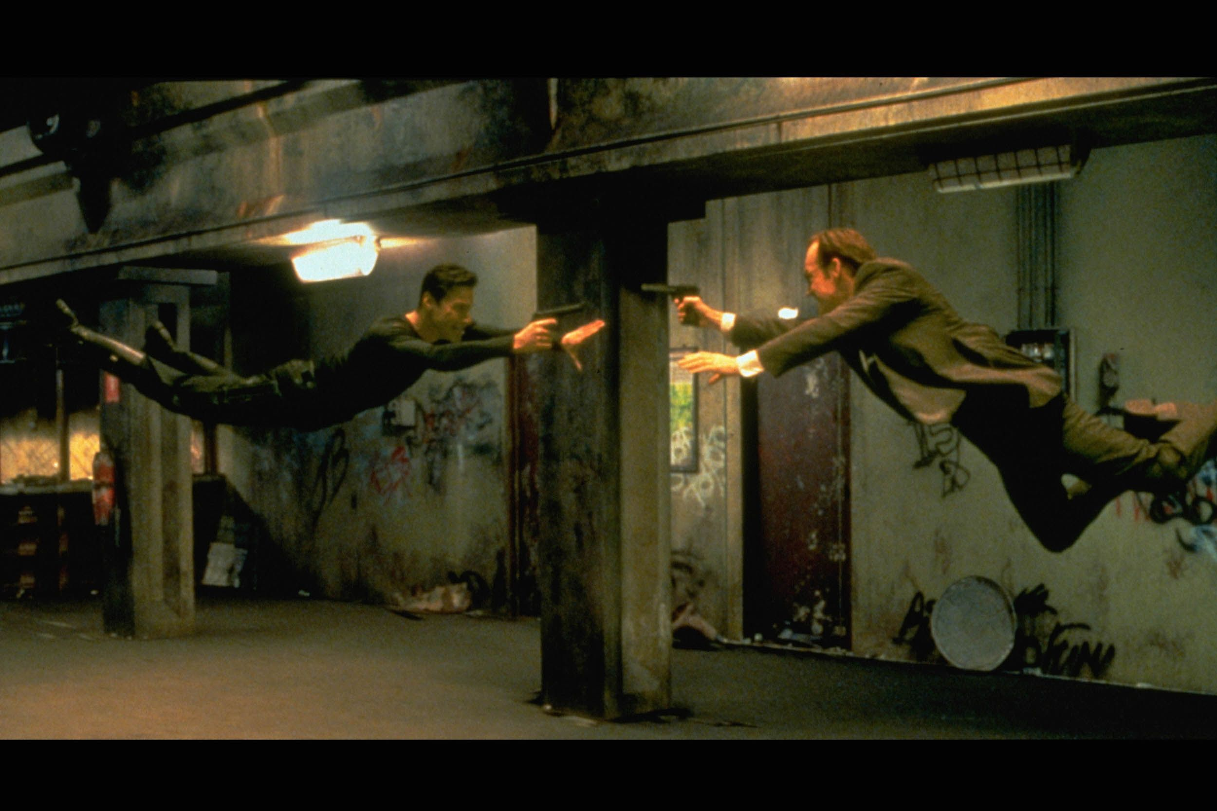 Keanu Reeves and Hugo Weaving in the 1999 film The Matrix.