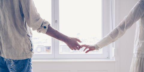 White, Hand, Arm, Gesture, Curtain, Standing, Window, Textile, Room, Interior design,