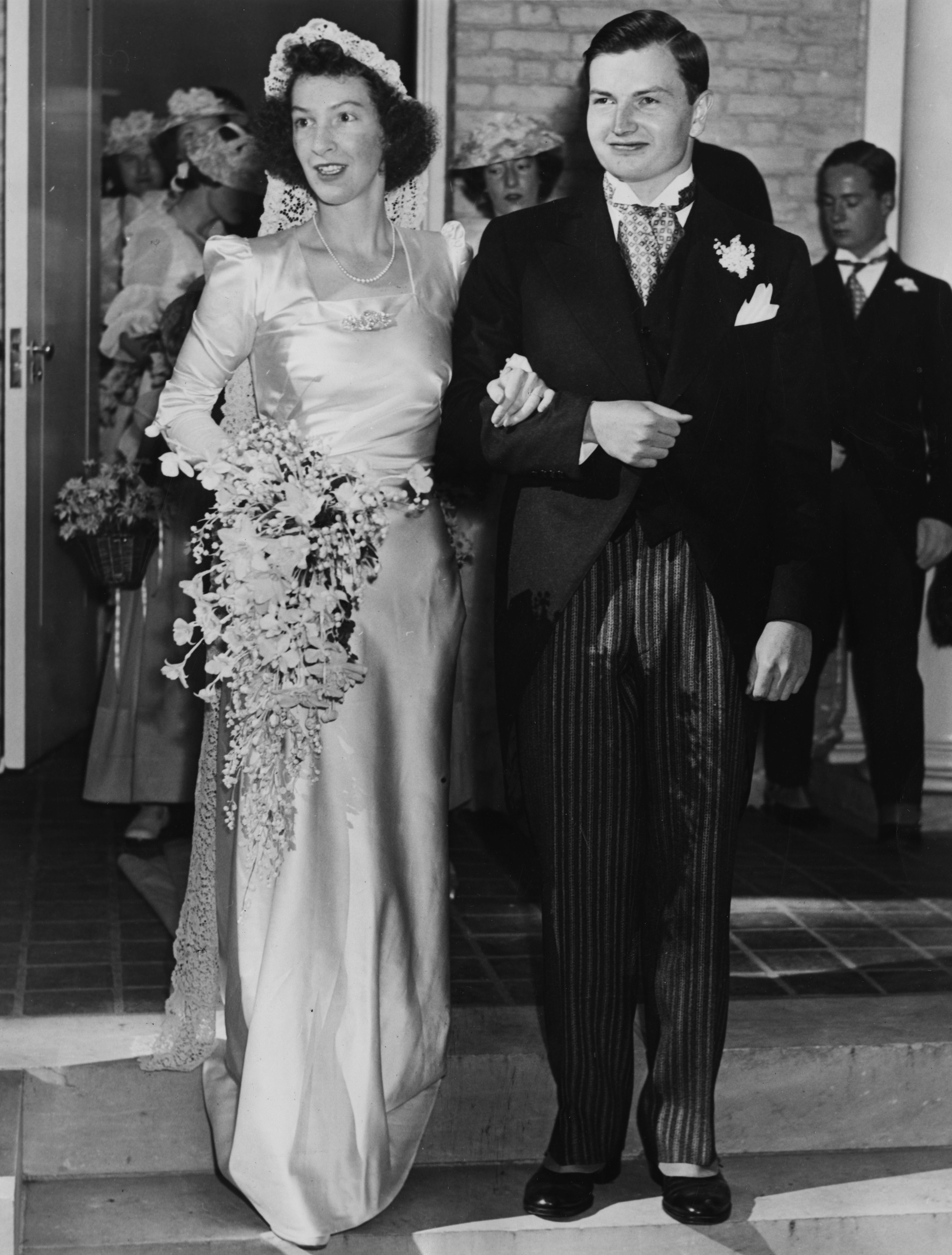 Margaret McGrath's Wedding Dress Almost ten years later in Bedford, NY, in 1940, his brother David Rockefeller (later the former chairman of the Chase Manhattan Bank and the Metropolitan Museum of Art) married Margaret McGrath and she wore a very similar gown—with slightly puffier sleeves. This, following a proposal made with a 5.6 carat rectangular step-cut diamond ring .
