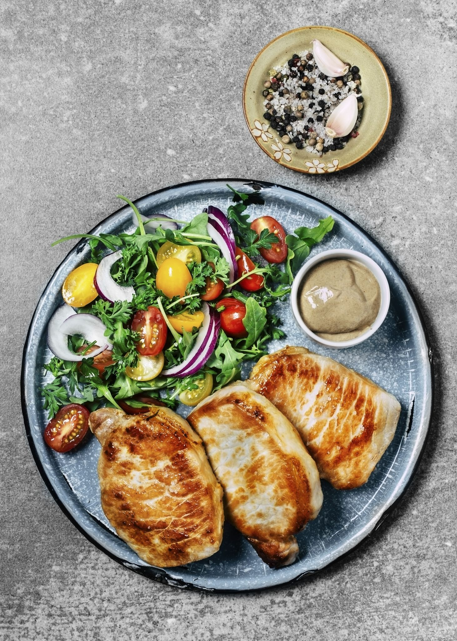 Roasted pork chops with salad