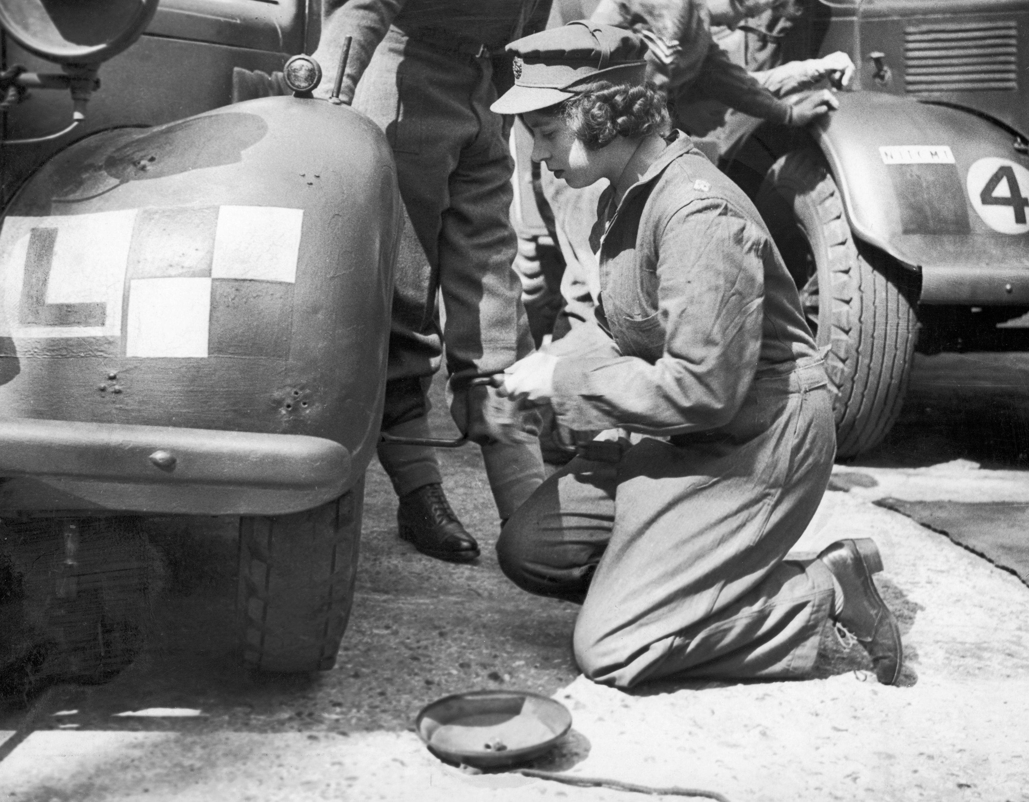 Princess Elizabeth learning basic car maintenance as a Second Subaltern in the A.T.S 12th April 1945.
