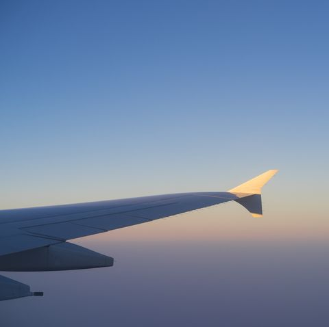Plane wing and clear sky during flight