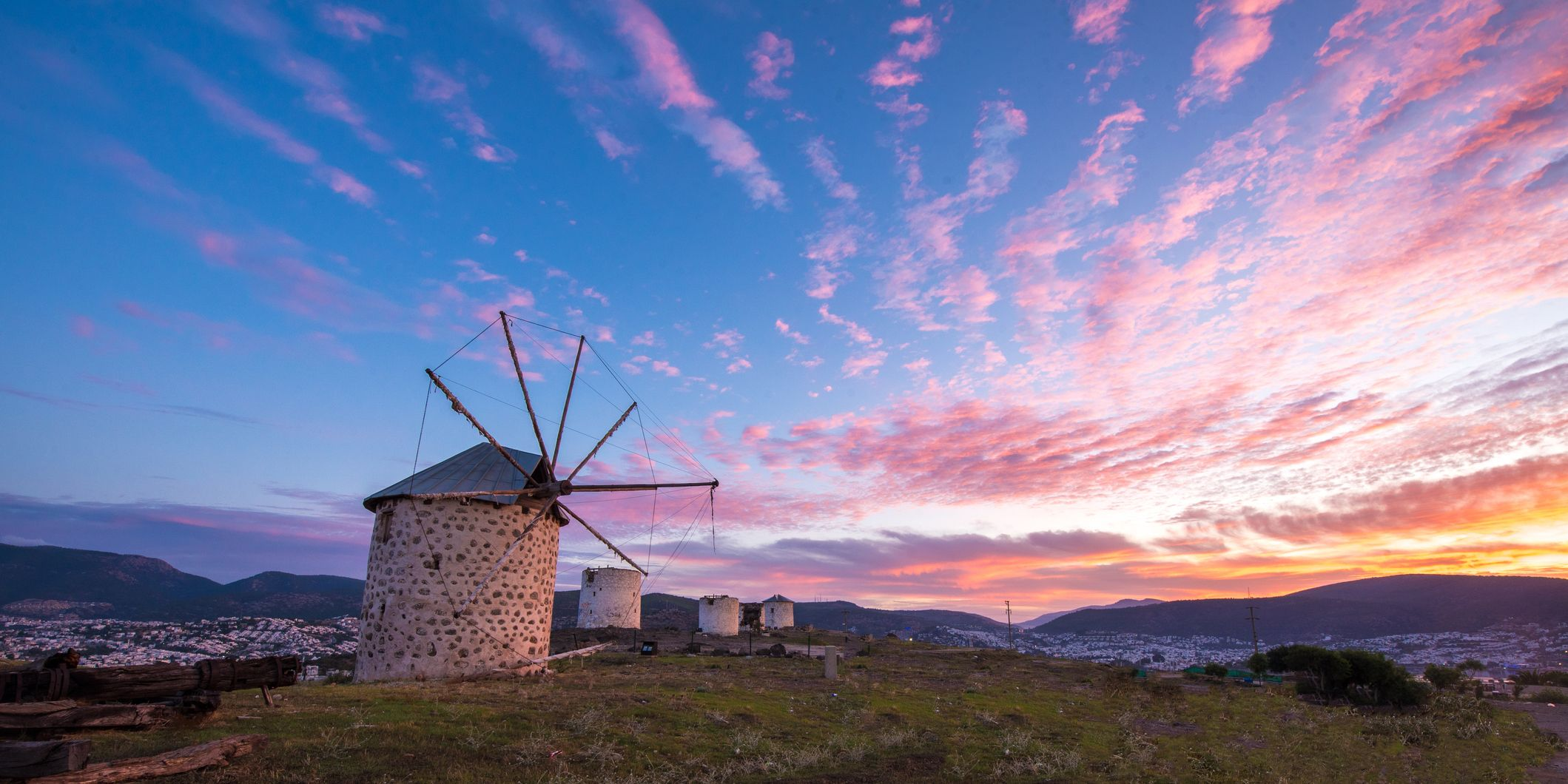 Windmills with sunrise sky in Bodrum