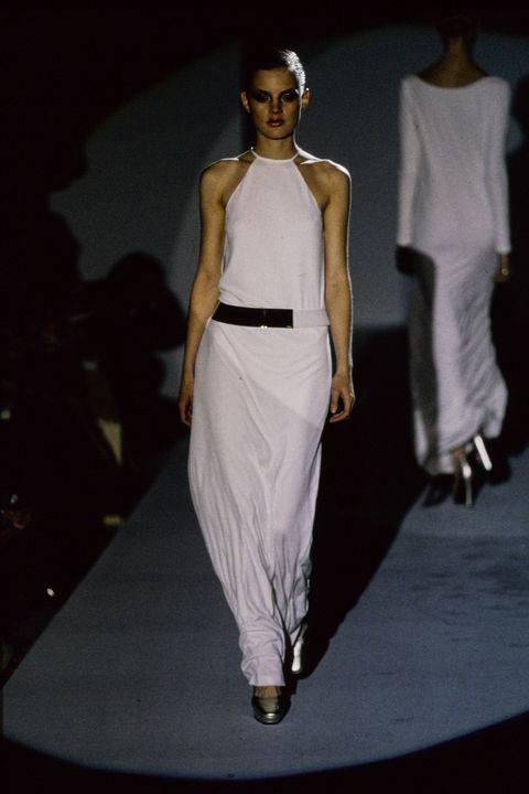 Fashion model, Fashion, Fashion show, White, Runway, Clothing, Shoulder, Fashion design, Dress, Haute couture,