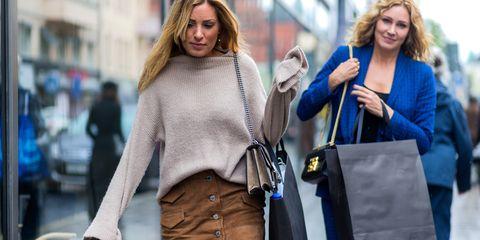 Street fashion, Fashion, Shopping, Shoulder, Cobalt blue, Electric blue, Jeans, Outerwear, Blond, Footwear,