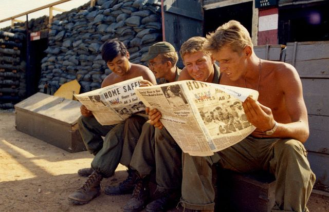 members of battery a, 7th battalion, 8th artillery, read the news of the apollo 13 splashdown in the stars and stripes newspaper, bien hoa, viet nam, april, 1970 left to right are spc 4 patrick rogan, spec 4 neal goldworth, cpl jerry isokane and spec 4 bruce barling photo by photoquestgetty images