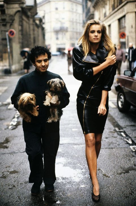france   february 1  fashion designer azzedine alaia holding his two yorkshire terriers, patapouf and wabo, walking in paris street with model frederique who wears one of his creations, a black leather zippered dress  credit must read arthur elgortconde nast via getty images photo by arthur elgortconde nast via getty images