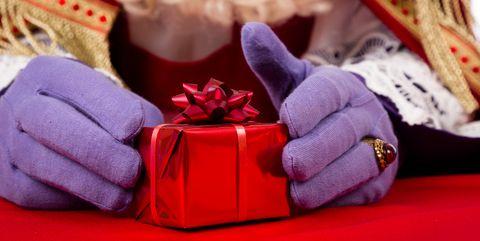 Hands of Sinterklaas with present