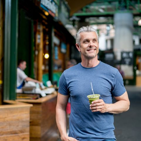 Healthy man having a smoothie